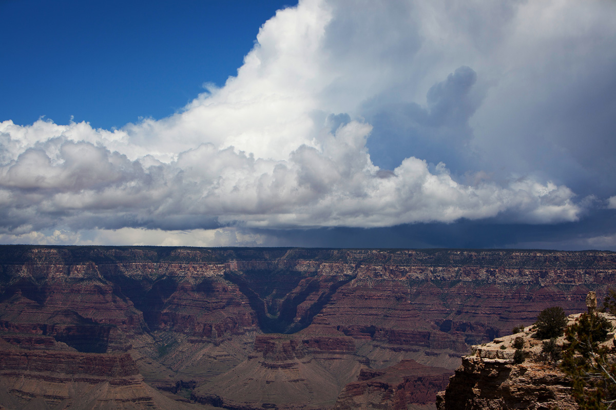 storm clouds gather over the grand canyon