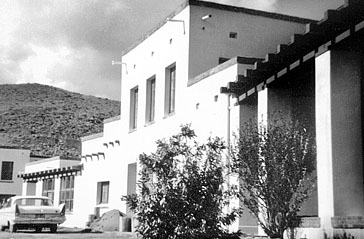 an old b&w photo of the exterior of the douglas mansion in jerome az
