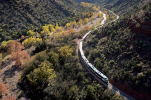 an aerial view of the verde canyon railway locomotive with fall colors